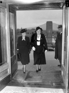 Senator Dorothy M Tangney (left) and Dame Enid Lyons GBE entering the front door of the House of Representatives.